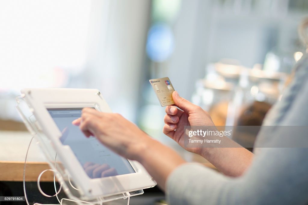 Close-up of female using touch screen : Stockfoto
