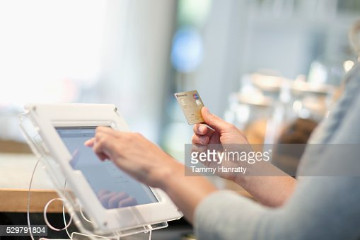 Close-up of female using touch screen : ストックフォト