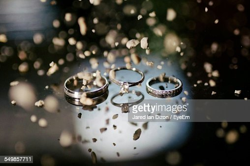 Close-Up Of Finger Rings On Table