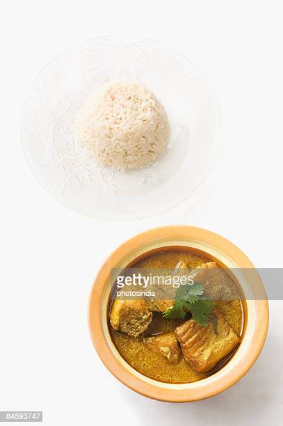 Close-up of fish curry in a bowl served with boiled rice