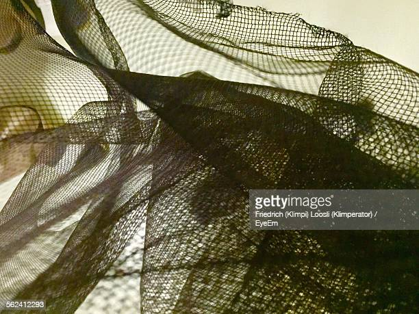 Close-Up Of Fishing Net Against Wall