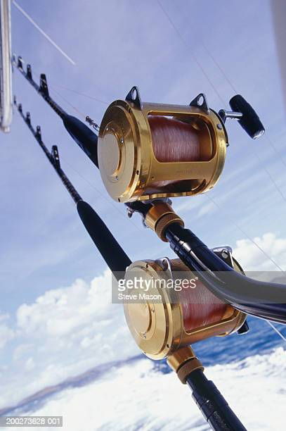 Close-up of fishing rod mounted on back of boat, close-up