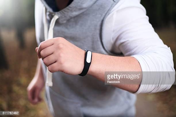Closeup of fitness bracelet during park jog