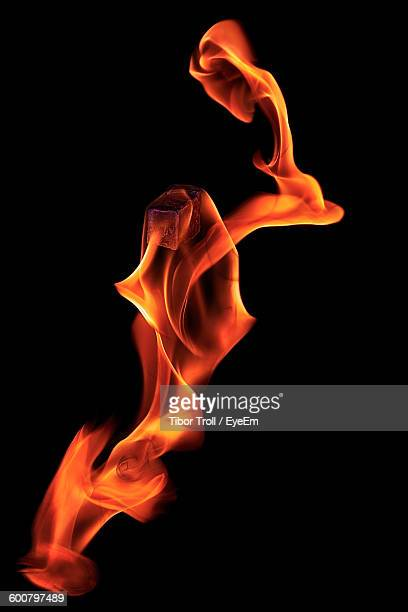 Close-Up Of Flame Against Black Background