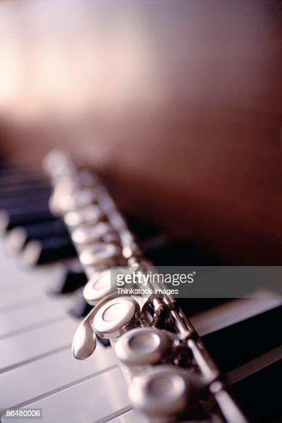 Close-up of flute on piano keys