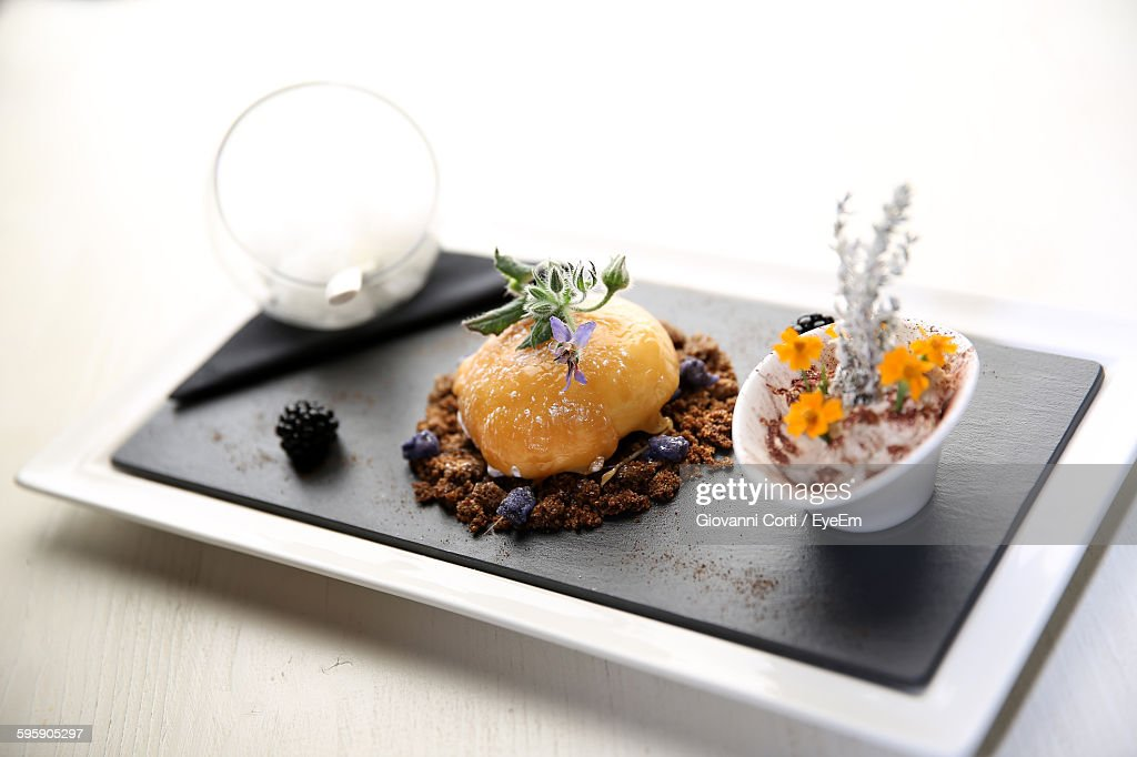 Close-Up Of Food In Plate On Table Against Wall