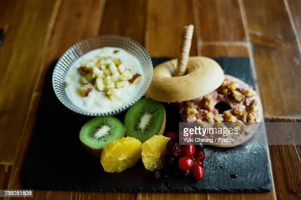 Close-Up Of Food Served On Wooden Table