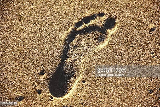 Close-Up Of Footprint On Sand
