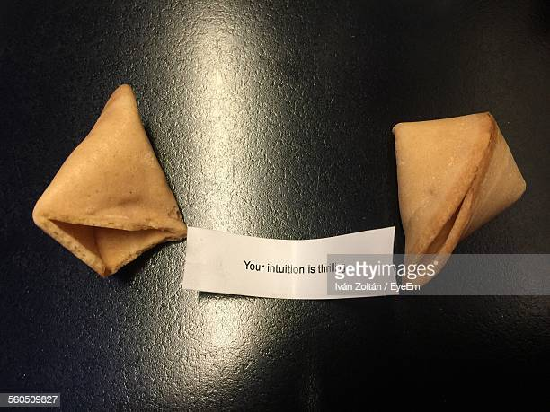 Close-Up Of Fortune Cookies With Message Label