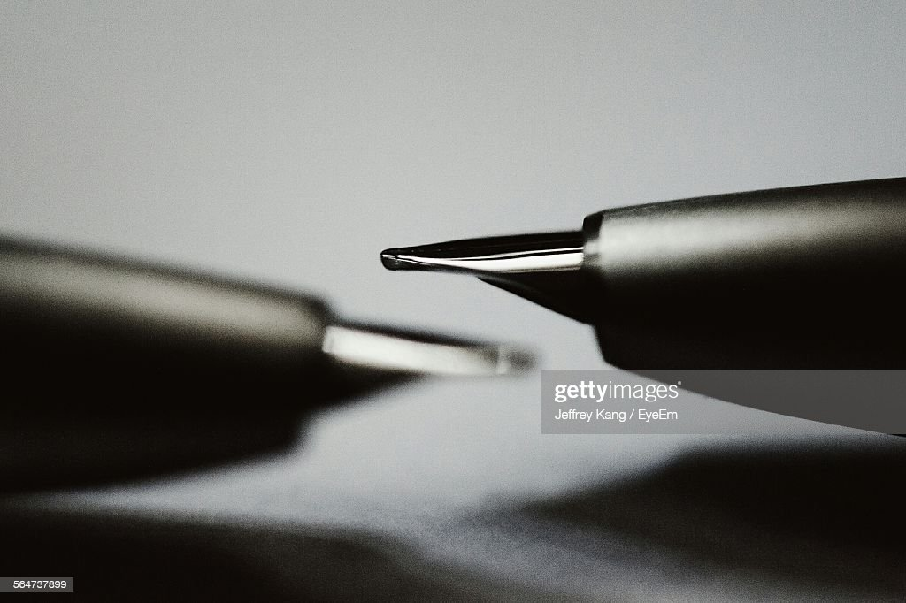 Close-Up Of Fountain Pens On Table