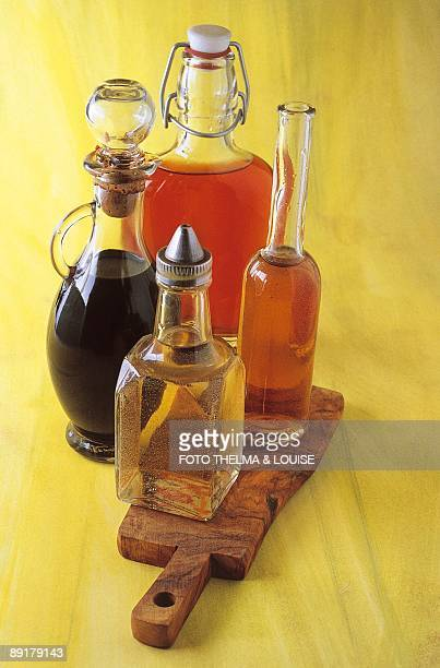 Closeup of four bottles of vinegar