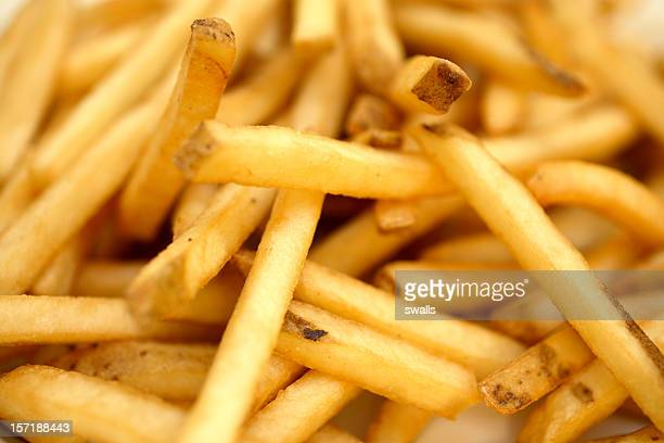 Close-up of French fries on white plate