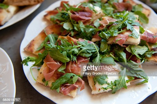 Close-Up Of Fresh Flatbread Prosciutto Pizza Served In Plate
