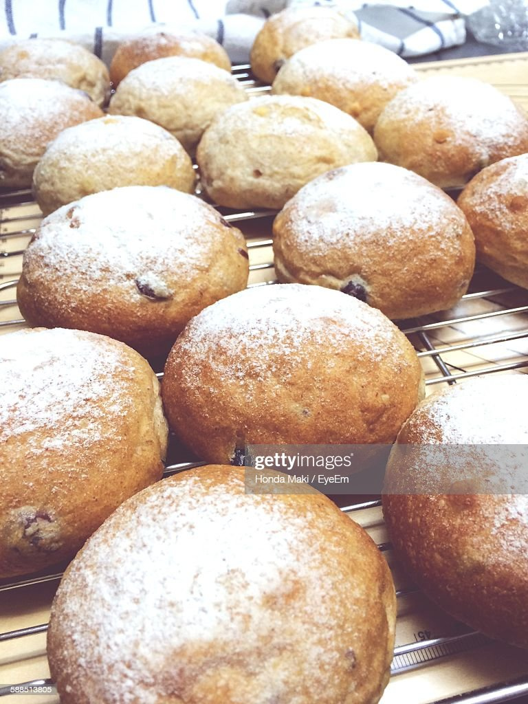 Close-Up Of Fresh Homemade Baked Bread On Metal Grate