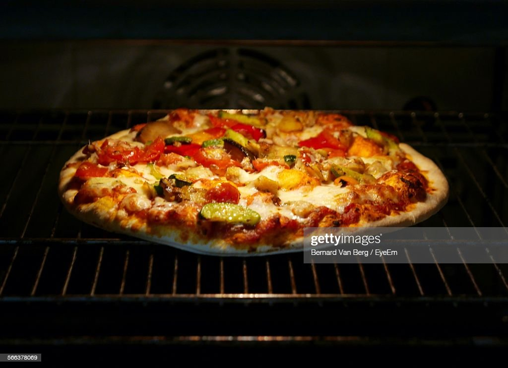Close-Up Of Fresh Pizza Baking In Oven
