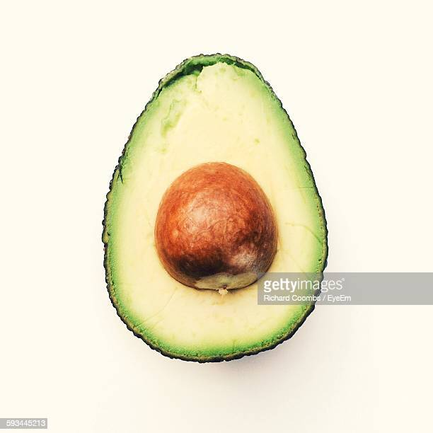 Close-Up Of Fresh Sliced Avocado Against White Background