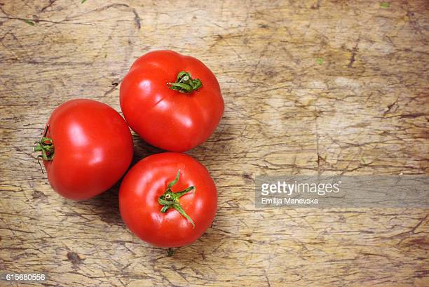 Close-up of fresh tomatoes on wood background