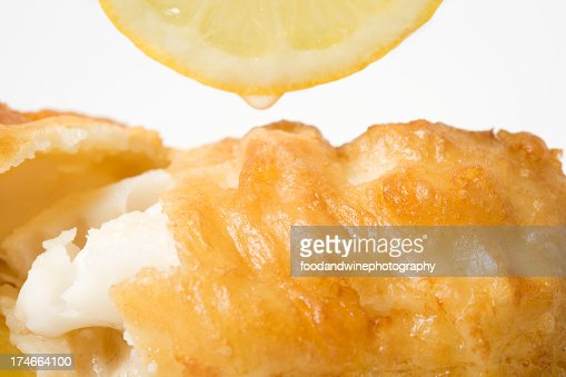 Close-up of fried fish with lemon on it