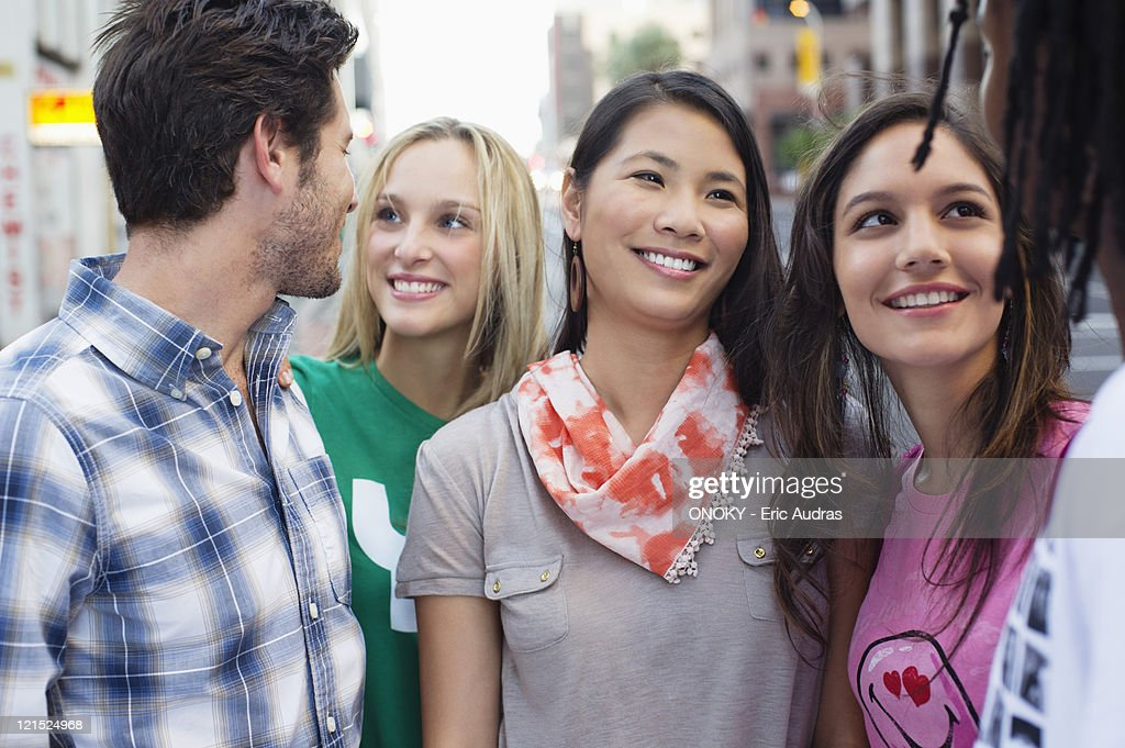 Close-up of friends standing together and smiling : Stock Photo