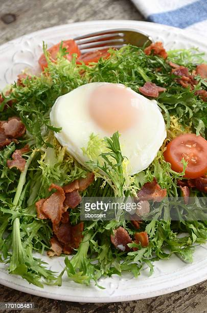 Close-up of Frisee salad with lardons and poached egg