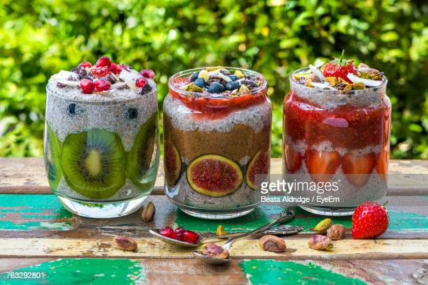 Close-Up Of Fruit Drinks In Jars On Table