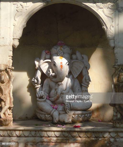 Close-Up Of Ganesha Statue In Niche