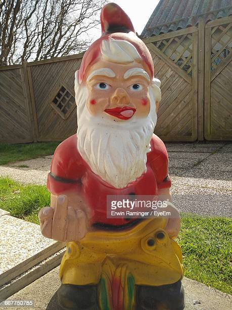 Close-Up Of Garden Gnome In Yard