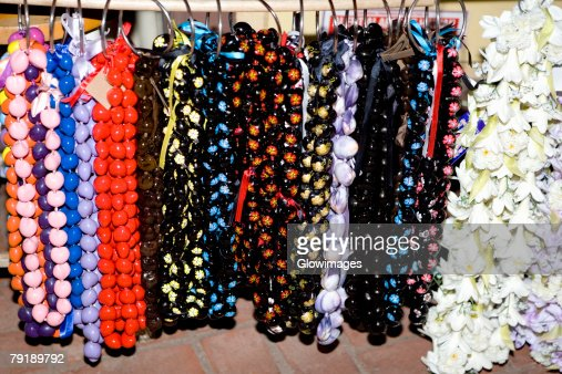 Close-up of garlands and necklaces hanging in a store : Stock Photo