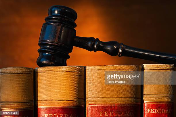 Close-up of gavel on lawyer books