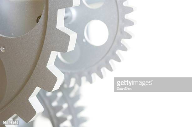 Close-up of gears on white background