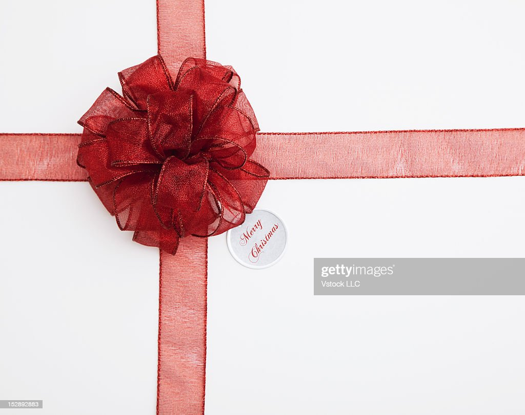 Close-up of gift with red ribbon