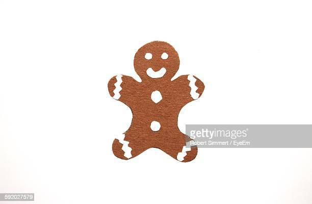 Close-Up Of Ginger Bread Against White Background