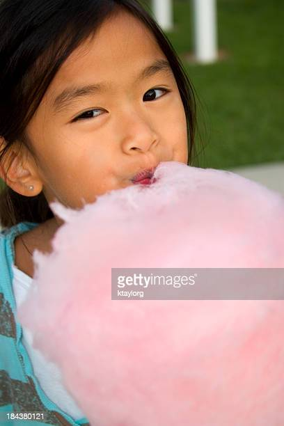 Closeup of girl and cotton candy