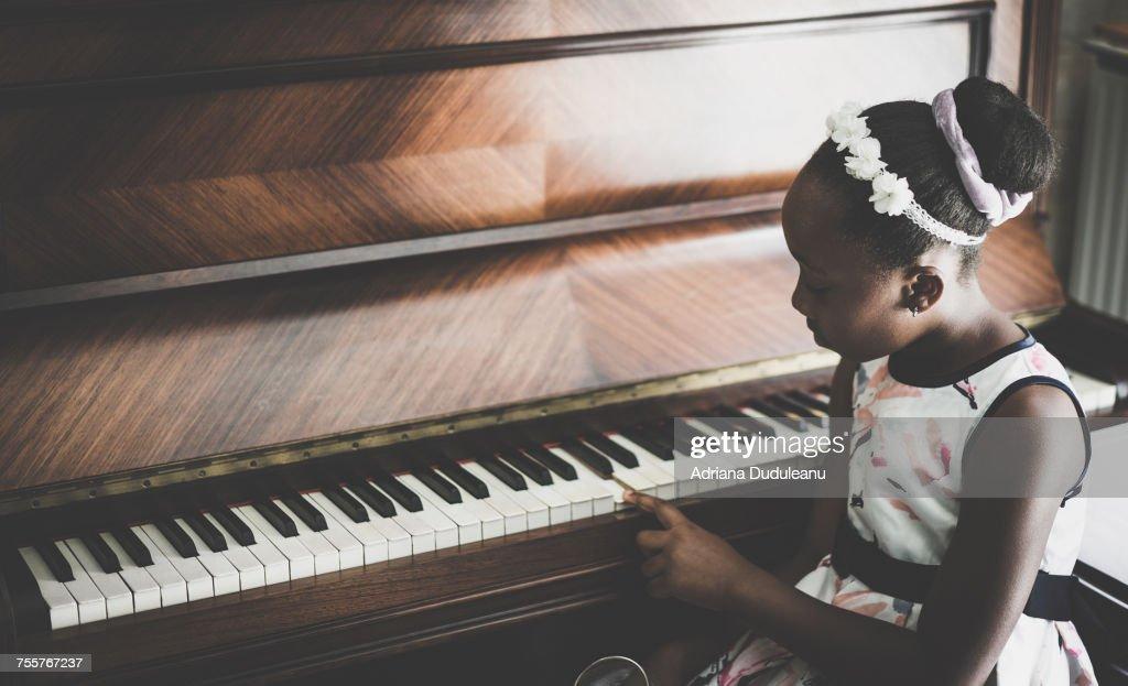 Close-Up Of Girl At Piano : Stock Photo
