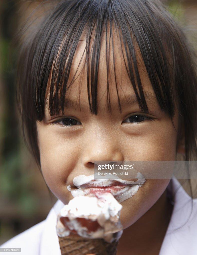 Closeup of girl eating ice cream #2 : Stock Photo
