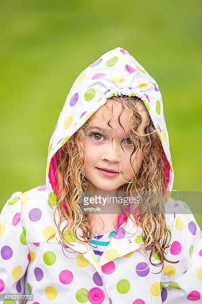 Close-Up of Girl In Polka Dot Rain Coat