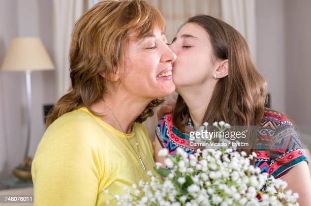 Close-Up Of Girl Kissing Mother