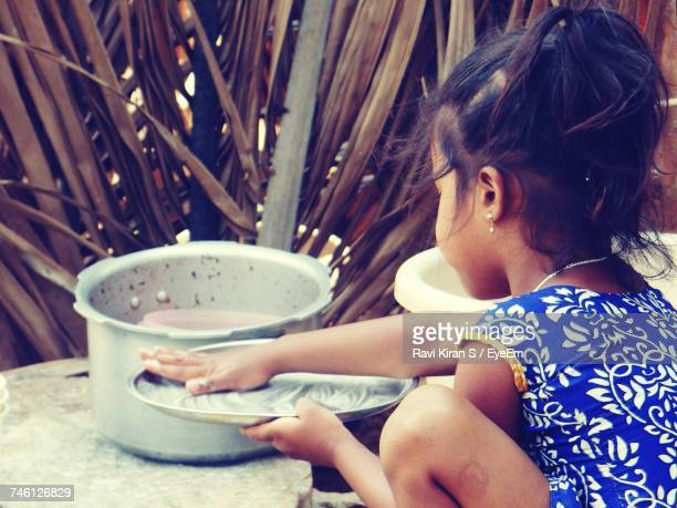 Close-Up Of Girl Washing Plate