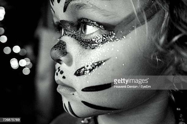 Close-Up Of Girl With Face Paint