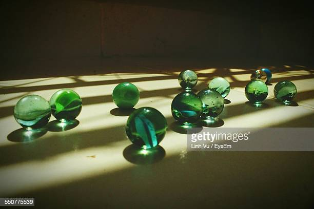 Close-Up Of Glass Marbles On Floor
