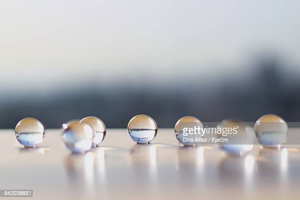 Close-Up Of Glass Marbles On Table