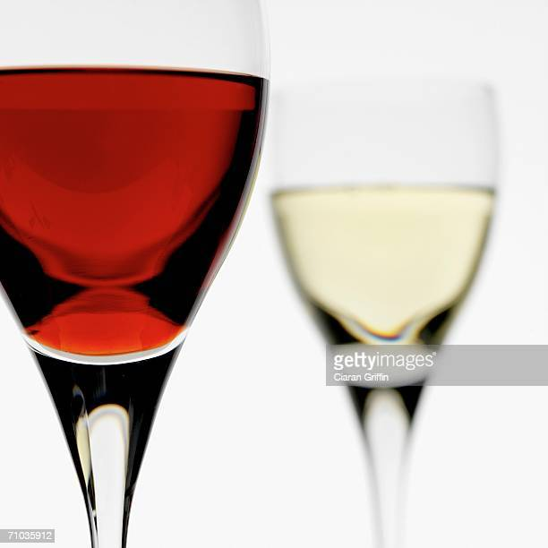 Close-up of glass of red wine with glass of white wine in the background