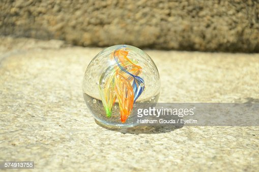 Close-Up Of Glass Paperweight On Floor