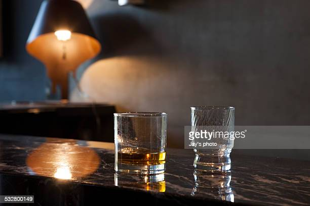 Close-up of glasses of whiskey and water on table