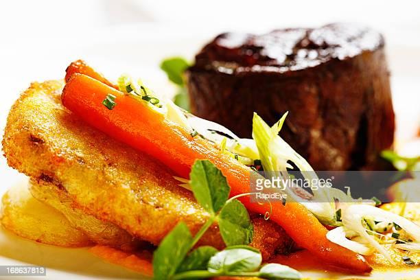 Close-up of glazed vegetables accompanying grilled steak