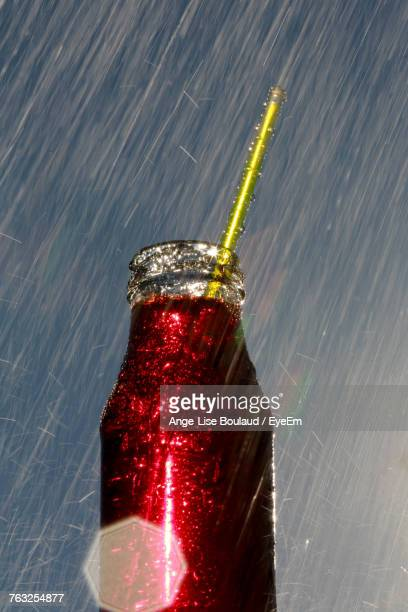 Close-Up Of Glittering Bottle Against Abstract Background