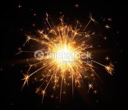 Close-up of glittering sparkler : Stock Photo