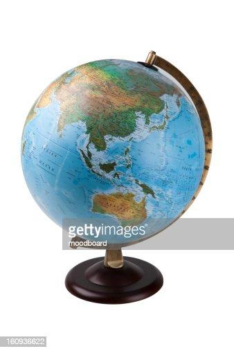 Close-up of globe over white background : Foto de stock