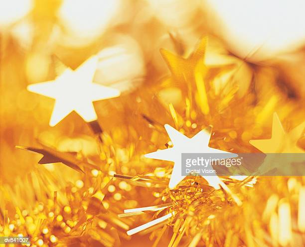 Close-up of Gold Tinsel and Stars