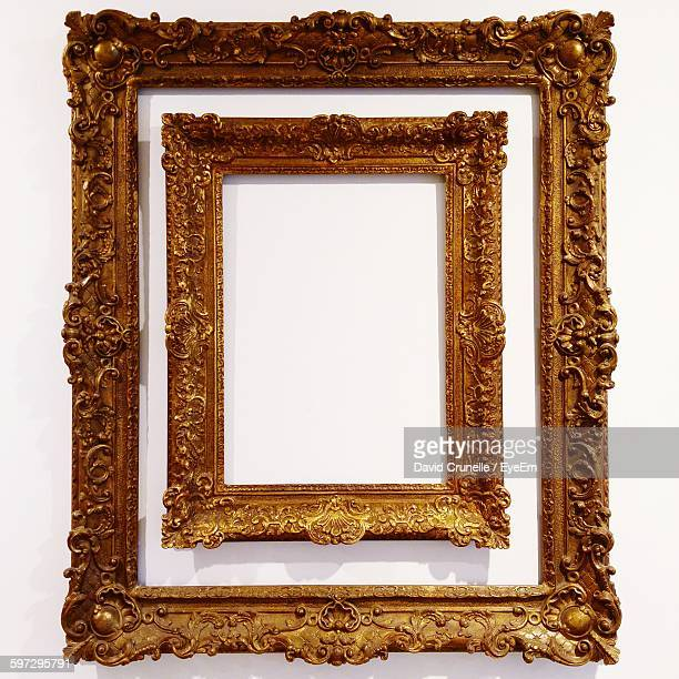 Close-Up Of Golden Frame On White Wall